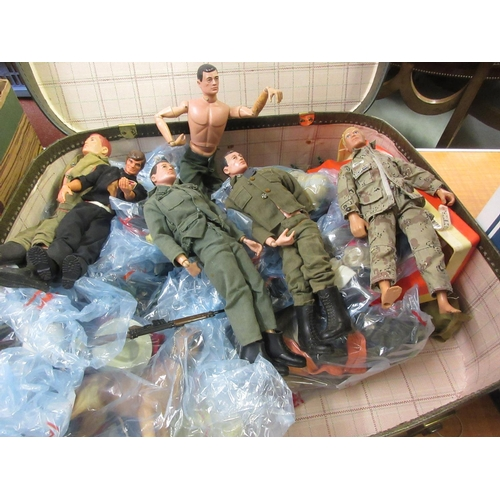 77 - Large collection of Action Man dolls, clothing, vehicles etc...