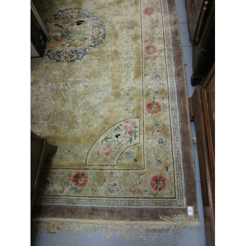 8 - Chinese silk and woollen rug of all over floral design on a beige ground, 8ft x 5ft...