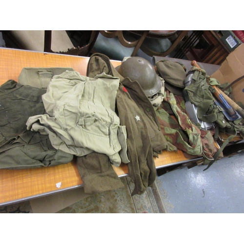 81 - Quantity of various British and other Army uniforms and accessories, together with two framed prints...