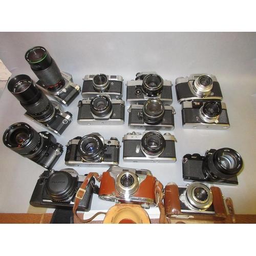 85 - Olympus OM10 35mm camera with zoom lens, similar Nikkormat camera, a Nikon EM 35mm camera and twelve...