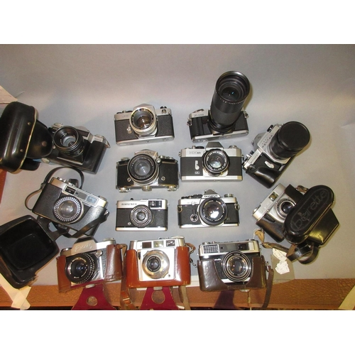 88 - Minolta X300 35mm camera with zoom lens, Canon EX auto, Olympus OM2 and ten other various 35mm camer...