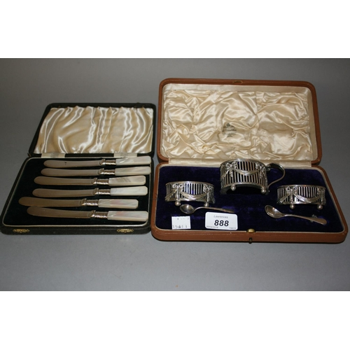 888 - Edwardian three piece cased silver condiment set of bow and swag design, together with a cased set o...