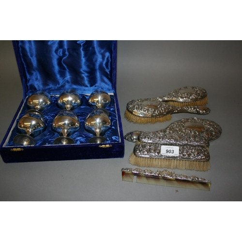903 - Silver mounted five piece dressing table set and a boxed set of plated goblets...