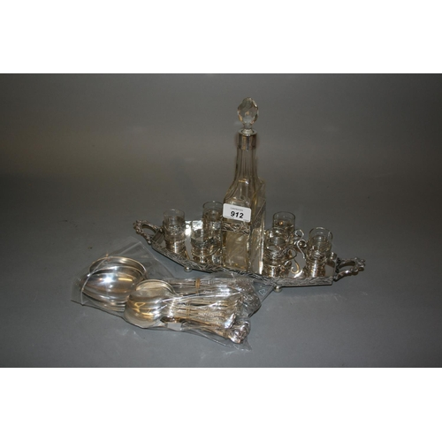 912 - Continental silver plated and glass liqueur set on stand (chip to one glass) together with a quantit...