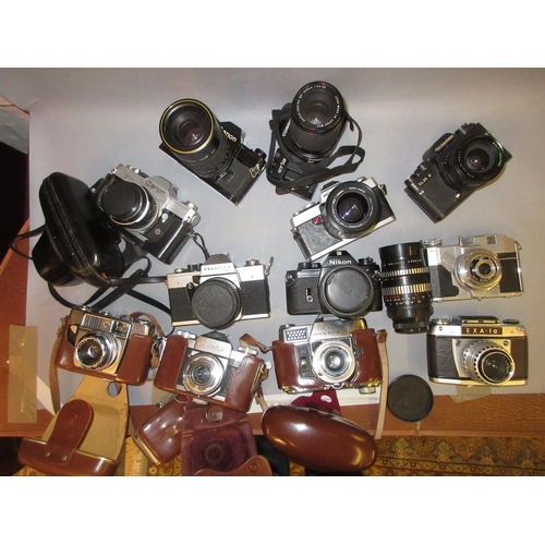 92 - Praktica 35mm camera with two lenses, Rolleiflex 35mm camera and ten other various 35mm cameras...