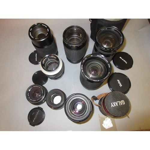 97 - Quantity of various telephoto and other lenses...