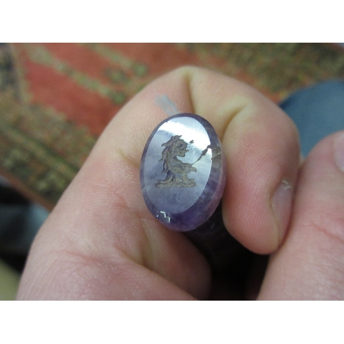 62 - Faceted amethyst table seal...