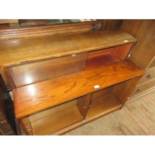 2408 - Small 1930's oak chest of four drawers with carved and moulded panel fronts on bulbous supports, tog...
