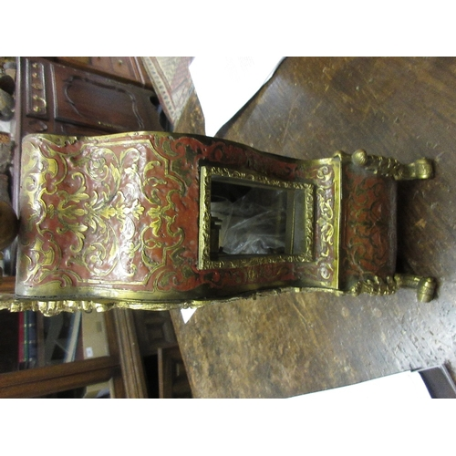 1856 - 19th Century red stained tortoiseshell buhl work mantel clock with figure surmount, the gilded dial ...