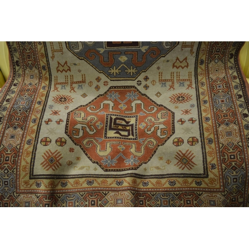 1 - 20th Century Caucasian design rug with triple medallion on ivory ground...