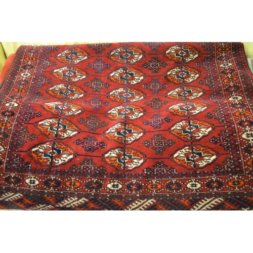 10 - Bokhara rug having multiple borders with three lines of gols on a wine ground, 4.5ft x 3ft...