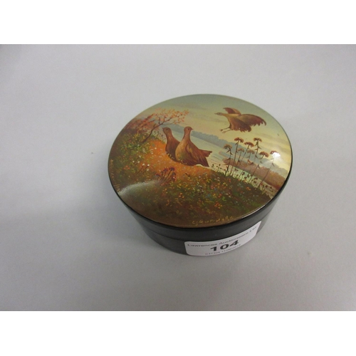 104 - Russian circular papier mache box, the cover painted with game birds in a landscape, signed indistin...