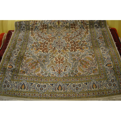 11 - Turkish rug having all-over floral and bird design with multiple borders on a beige and green ground...