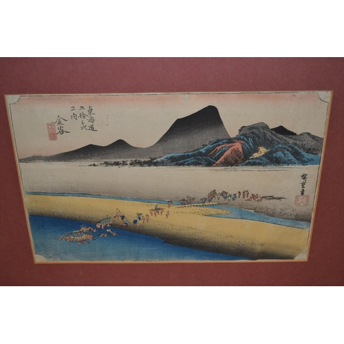 1228 - Two unframed Japanese woodblock prints, Tokaido Station by Utagawa Sadahide and figures crossing a r...
