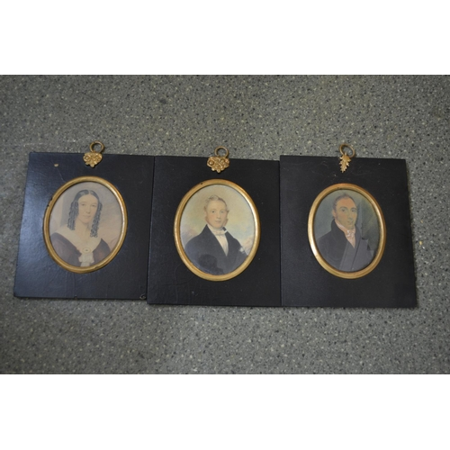 1230 - Three 19th Century miniature portraits of a lady and two gentlemen, ebonised and gilt frames...