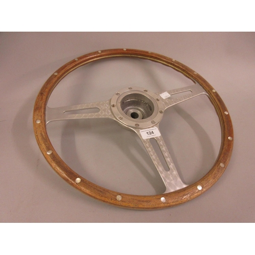 124 - Cast aluminium wooden and mother of pearl inlaid car steering wheel...