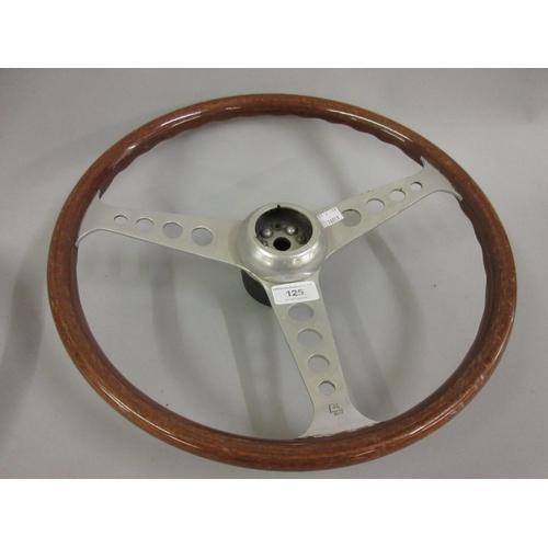 125 - Cast aluminium and wooden car steering wheel by Les Leston...