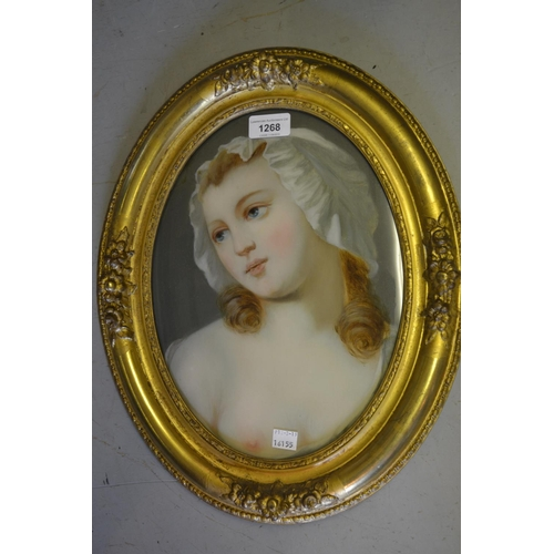 1268 - Pair of 19th Century French oval gilt framed verre eglomise pictures, portraits of girls, 12ins x 9i...