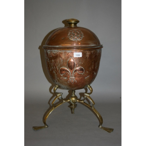 1284 - Art Nouveau brass and copper coal container of Arts and Crafts design decorated with a Tudor rose an...