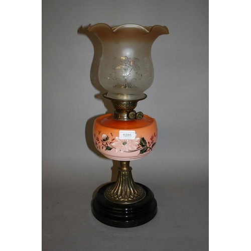 1295 - Brass oil lamp with a painted glass well and an etched glass shade...