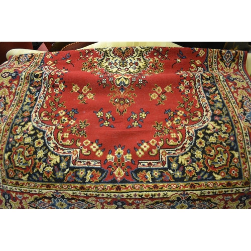 13 - 20th Century machine made Persian style rug having all-over floral decoration with multiple borders ...