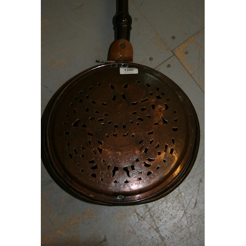 1300 - 17th Century copper bed warming pan, the pierced cover with repousse bird and floral decoration, wit...