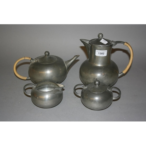 1302 - Dutch Arts and Crafts pewter four piece teaset...