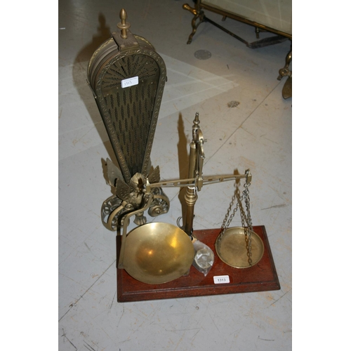 1313 - Pair of 19th Century brass balance scales on a mahogany base together with a brass fan shaped firesc...