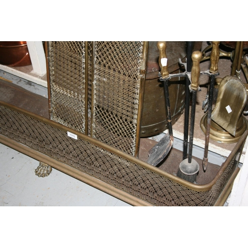 1315 - 19th Century pierced brass fender and a brass fireguard, fire irons etc...