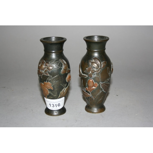 1316 - Pair of small Japanese bronze baluster form vases with relief decoration...