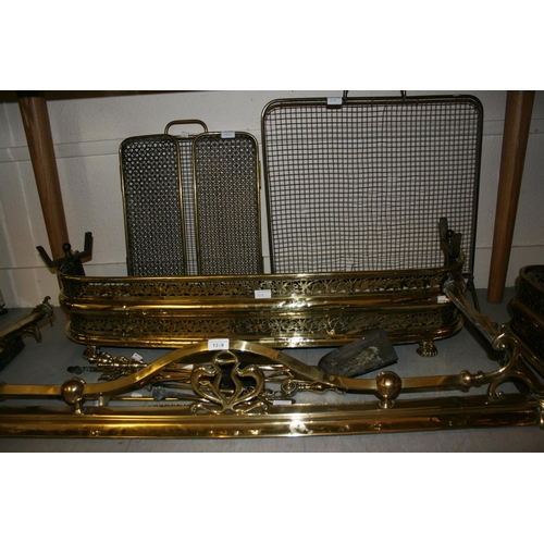 1319 - Two 19th Century brass fenders together with two brass firescreens and a quantity of fire tools...
