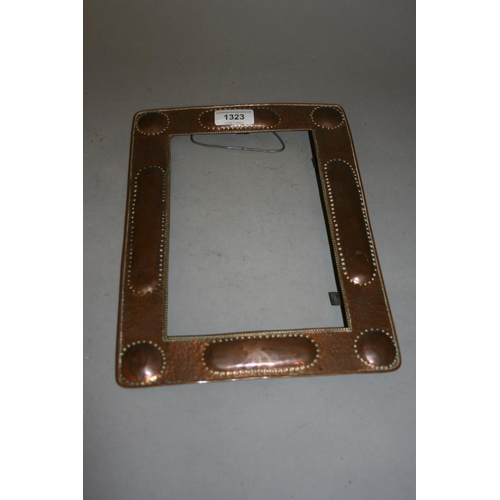 1323 - Arts and Crafts beaten and embossed copper rectangular photograph frame...