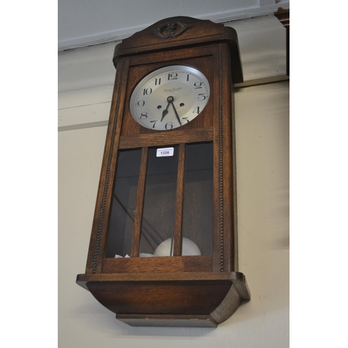 1326 - 1920's Oak cased two train wall clock, the dial inscribed Camerer Cuss and Co., 186 Uxbridge Road, W...