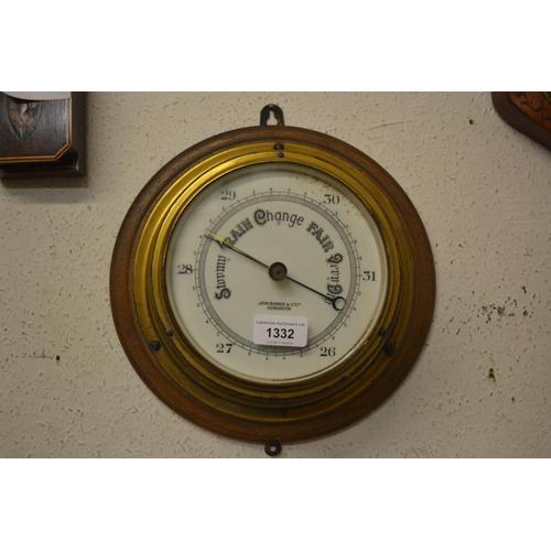 1332 - John Barker and Co., Kensington, circular gilt brass ship's bulkhead barometer...