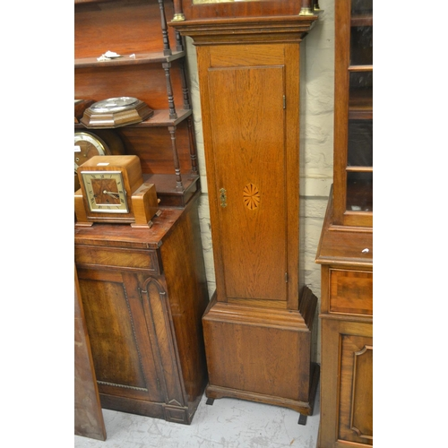 1334 - George III oak longcase clock, the arched hood above a rectangular shell inlaid panel door and plint...