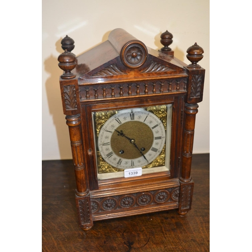 1339 - Late 19th or early 20th Century walnut bracket clock of Arts and Crafts design, the gilt brass dial ...