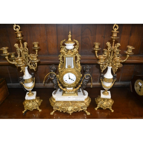 1342 - Large reproduction French style dark patinated gilt brass and marble clock garniture...