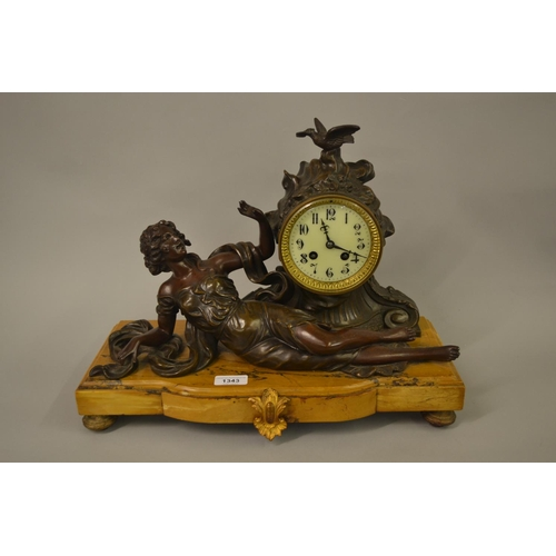 1343 - French brown patinated spelter figural two train mantel clock on a marble base...