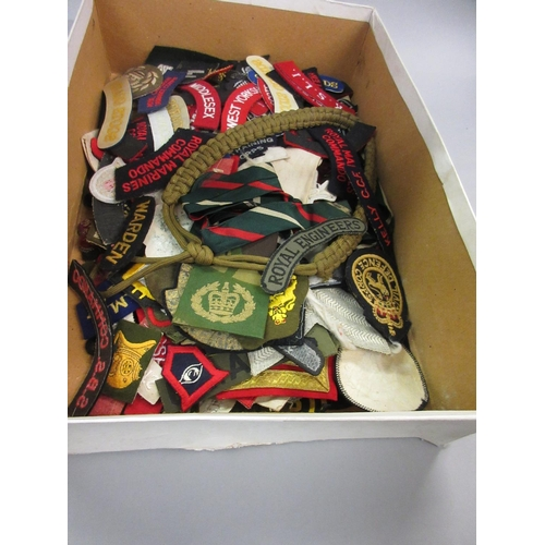 136 - Quantity of various military cloth badges...