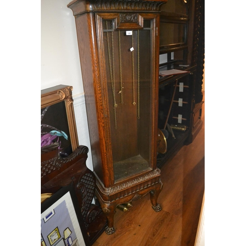 1381 - Early 20th Century carved oak longcase clock, the dome hood above a circular dial and moulded glazed...