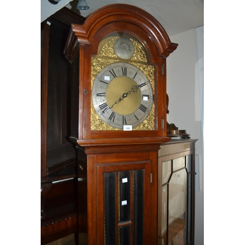 1382 - Mahogany longcase clock, the broken arch hood above a bevelled glass panelled door and conforming pl...