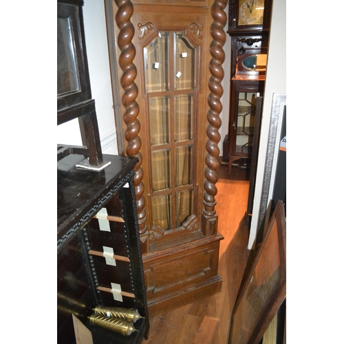 1383 - Early 20th Century oak longcase clock, the shaped moulded pediment with a carved floral cresting abo...