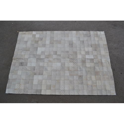 14 - Large modern patchwork cow hide rug...