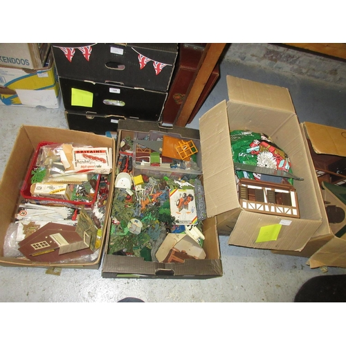 140 - Four boxes containing a large collection of Britain's farm toys...