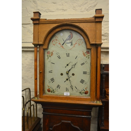 1416 - Oak longcase clock having a painted dial and two train eight day movement...