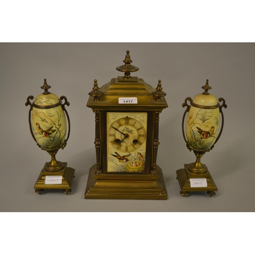 1417 - 19th Century gilt brass and porcelain clock garniture, the panels painted with various birds, with a...