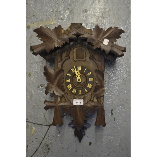 1418 - Swiss carved wooden two train weight driven cuckoo clock...
