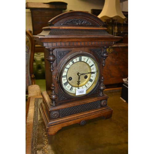 1422 - Late 19th Century German walnut mantel clock, the ceramic dial with Roman numerals with a two train ...