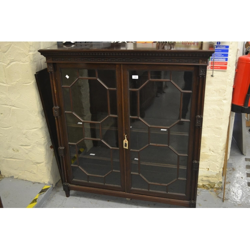 1426 - Edwardian mahogany bookcase, the carved dentil cornice above two astragal glazed doors flanked by tw...