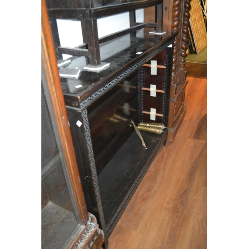 1427 - Edwardian mahogany open bookcase with a moulded top and blind fretwork frieze above adjustable shelv...